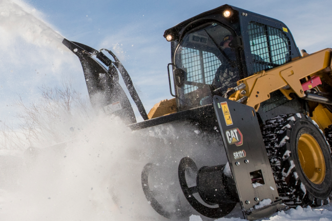 Skid steer loader with snow