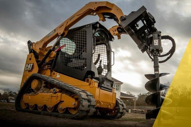 cat compact equipment drilling into the ground with a yellow triangle overlay on the image