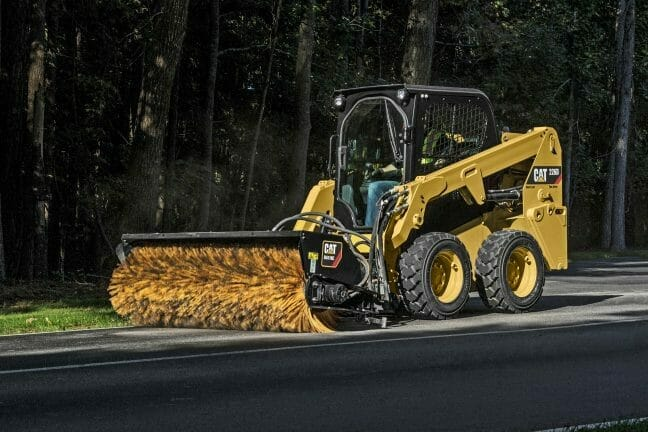 a cat machine brushing the street