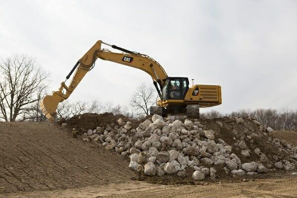 Cat Excavator Moving Dirt