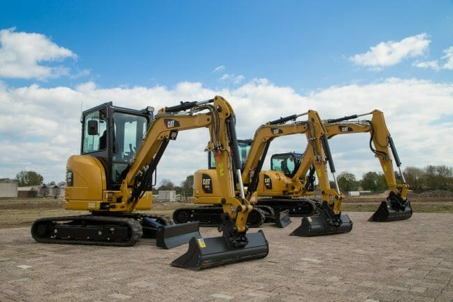 three cat mini hydraulic excavators outside