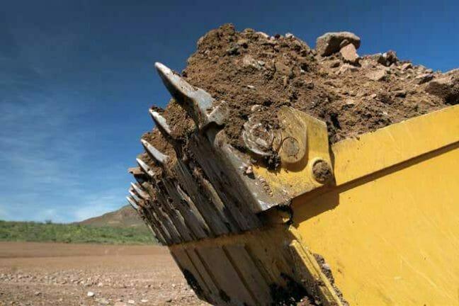 a cat machine shoveling dirt.