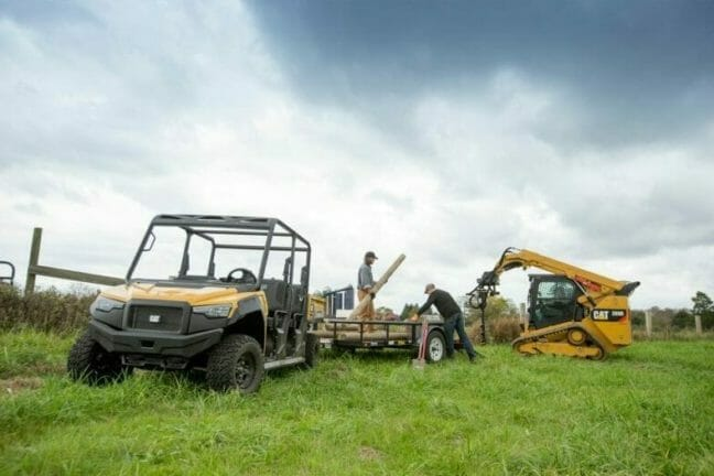 cat utv and excavator in a field