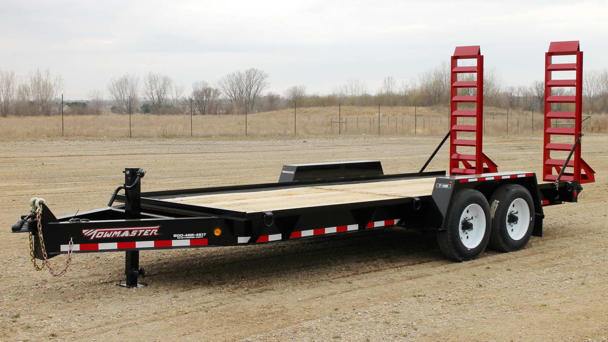 towmaster trailer wit the ramps lifted in the back