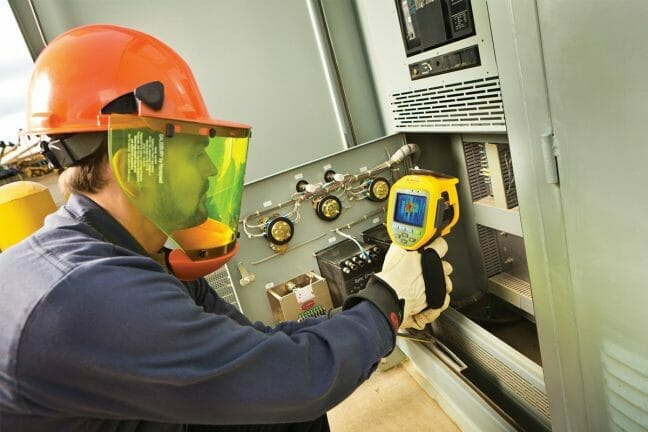 An image of a thermography technician scanning a reading