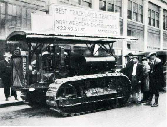 black and white photo of the ziegler cat company with a construction machine in the street