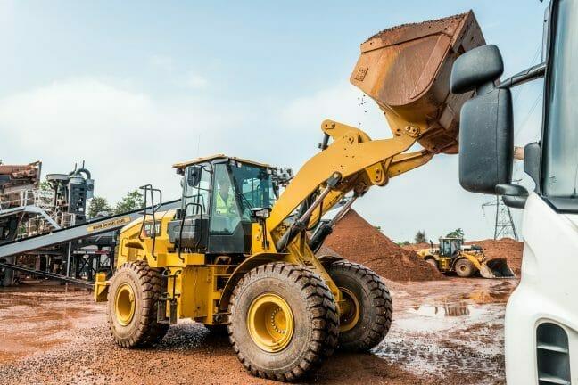 cat excavator picking up dirt