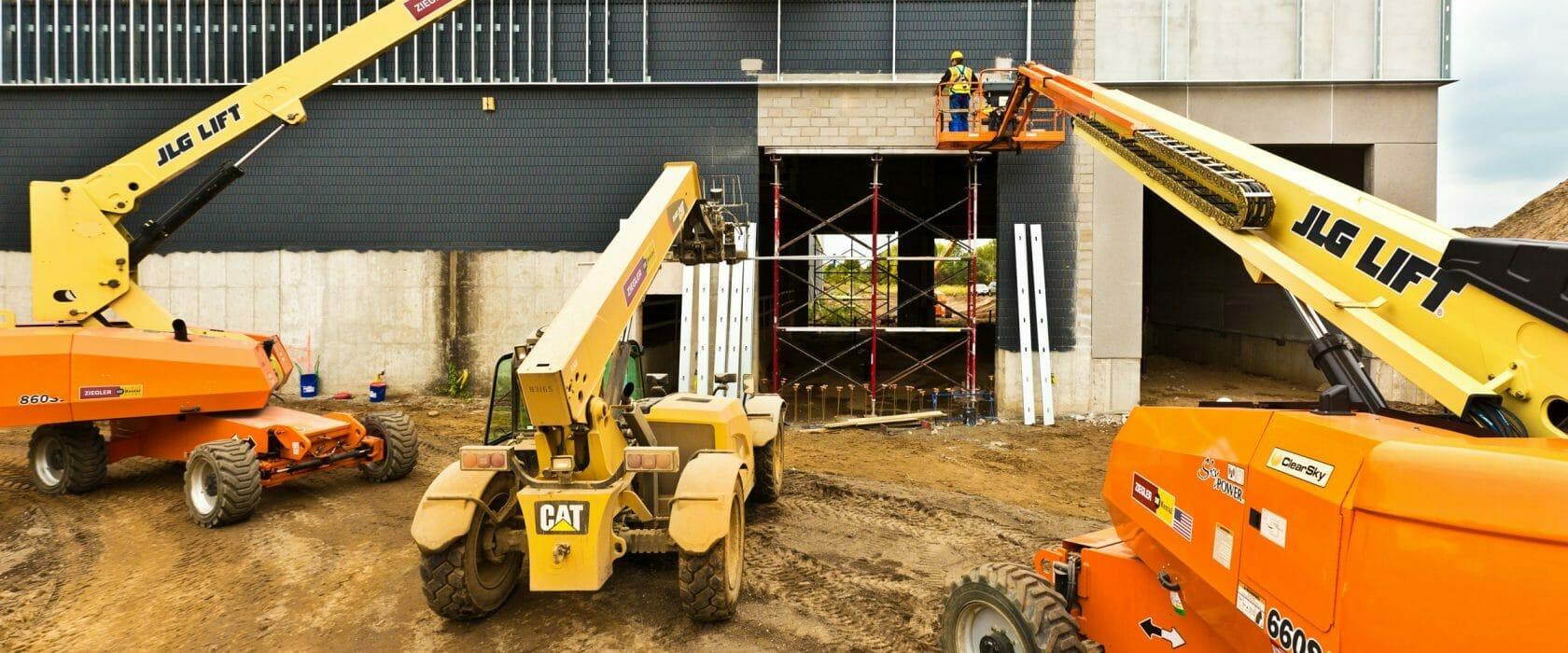 Cat heavy equipment rental machines constructing a building