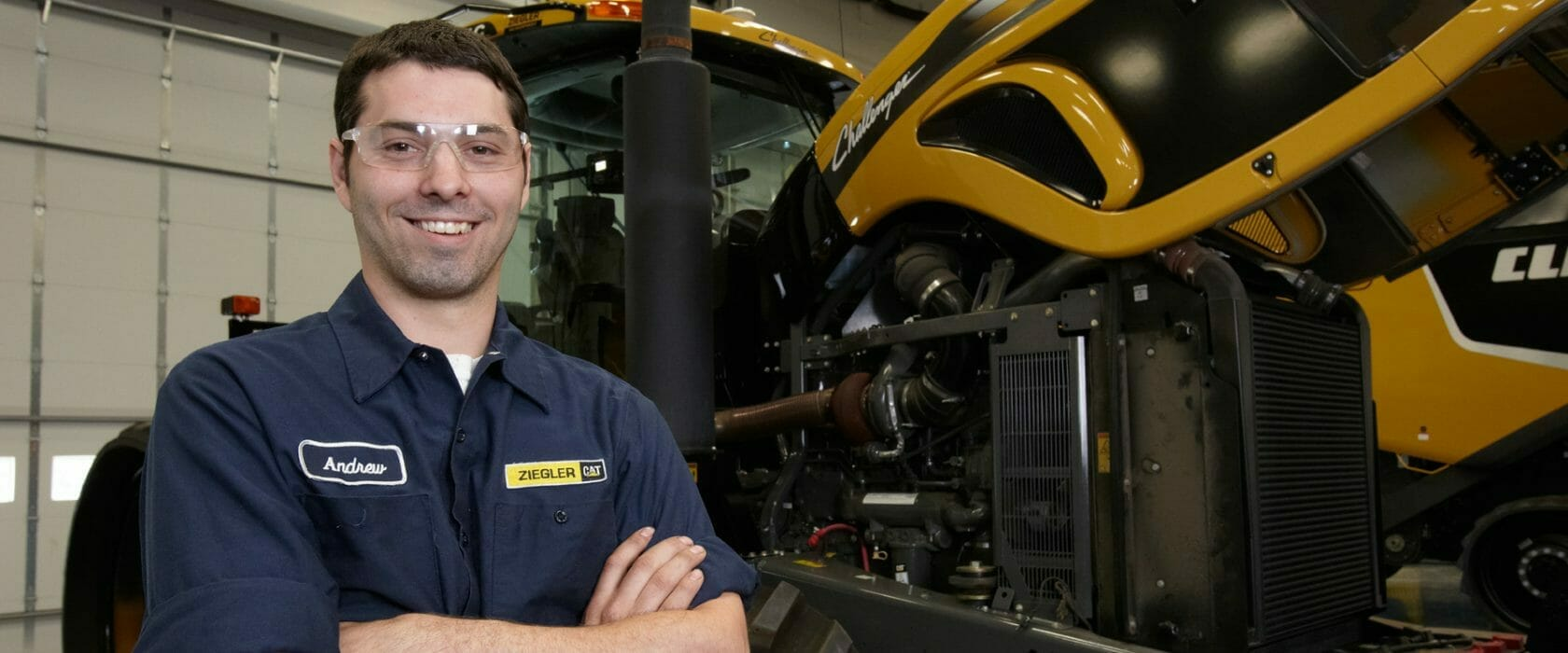 Employee standing next to used equipment