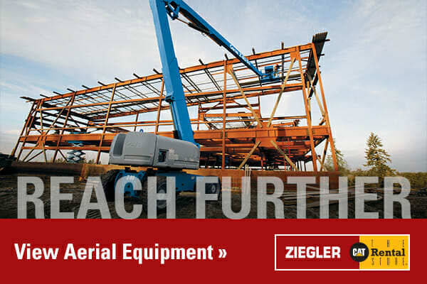 "An Image of a CAT machine constructing a building with the phrase ""reach further"" written across it"